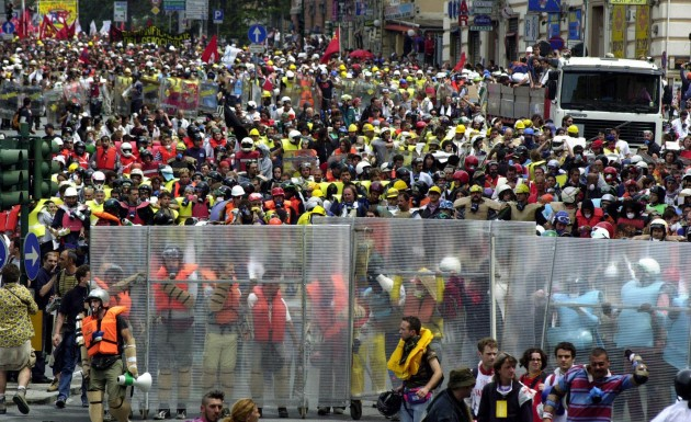 Demonstrators march in downtown Genoa, Italy, Friday, July 20, 2001 as protests against the G8 summit turned violent. Police fired tear gas to block demonstrators streaming toward the prohibited zone where the heads of the World's leading industrial countries were arriving for their annual G8 summit. (AP Photo/Luca Bruno)